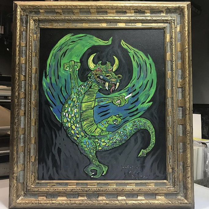 a painting of a dragon framed in a Dan Tag custom frame